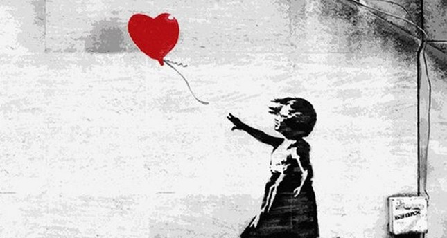 645×344-banksy-ed-iconic-girl-with-balloon-print-shreds-itself-after-selling-for-14m-at-auction-1538821975387
